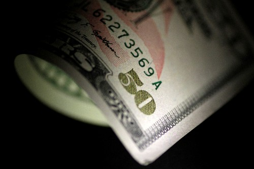 Dollar edges up in thin post-holiday trade after positive U.S. data