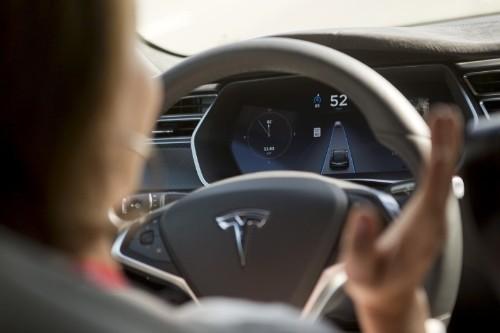 Tesla unveils autopilot system, but don't let go of the wheel
