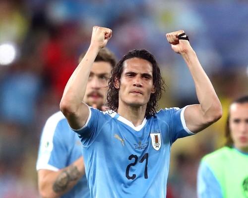 Soccer: Cavani pounces against Chile to give Uruguay top spot