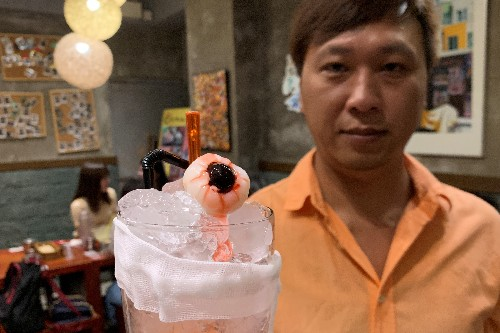 Hong Kong diners offered protest-inspired 'eyeball' mocktails and 'tear gas' eggs