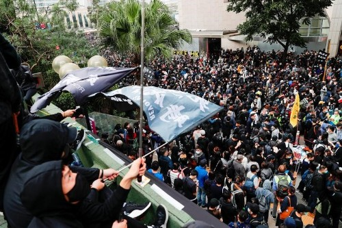 Police arrest organiser of Hong Kong protest after rally turns violent
