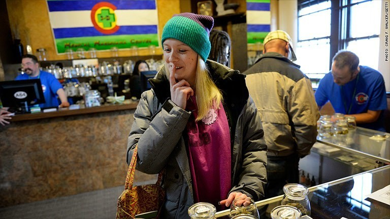 Tourists flock to Colorado to smoke legal weed