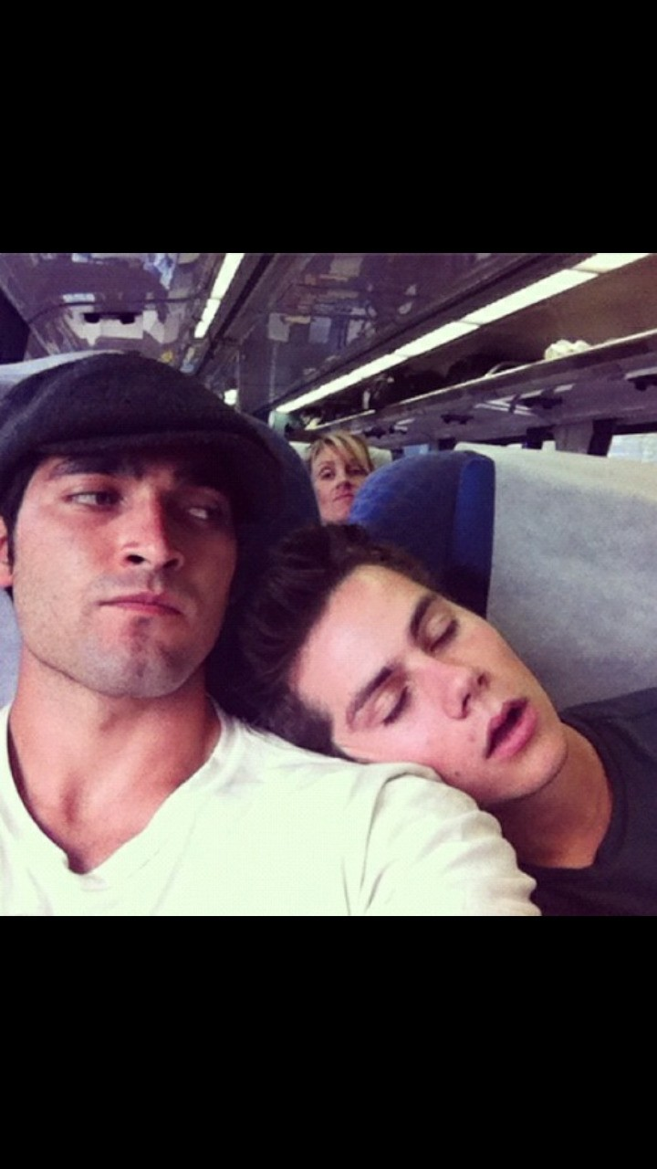 still cute even when he is sleeping and total photo bomb in the back of them