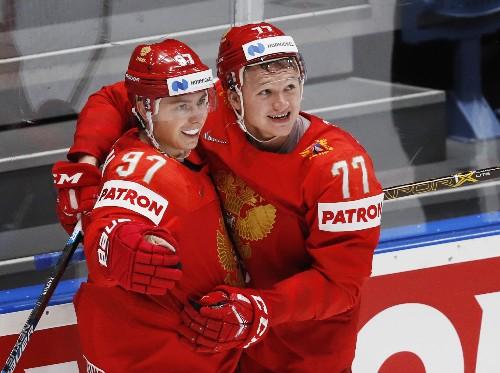 Russia, Canada reach world championship semis