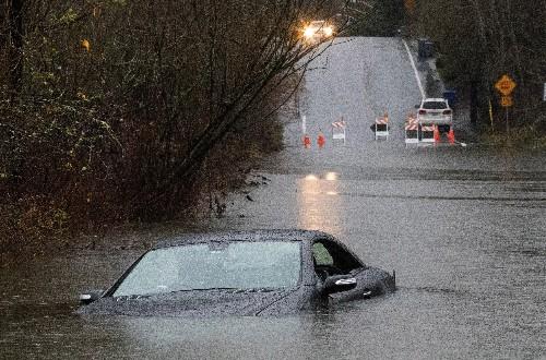 Record rain, darkness: Seattle braces for floods, mudslides