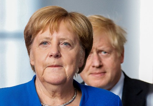 Protesters cry 'stop Brexit' as UK PM Johnson meets Merkel in Berlin