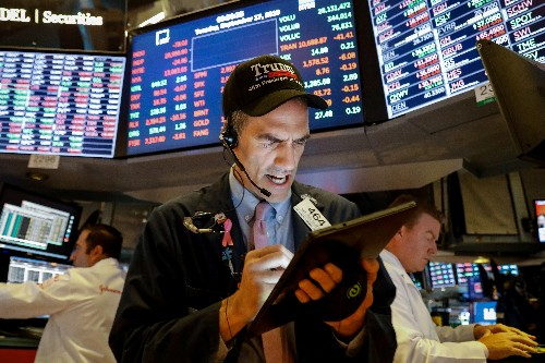 Wall Street ticks lower as FedEx warns on profit; Fed on tap