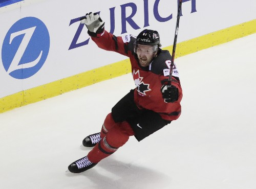 Canada survives in OT, U.S. falls in IIHF quarters