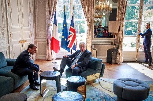 UK's Boris Johnson puts his feet up in Macron's palace
