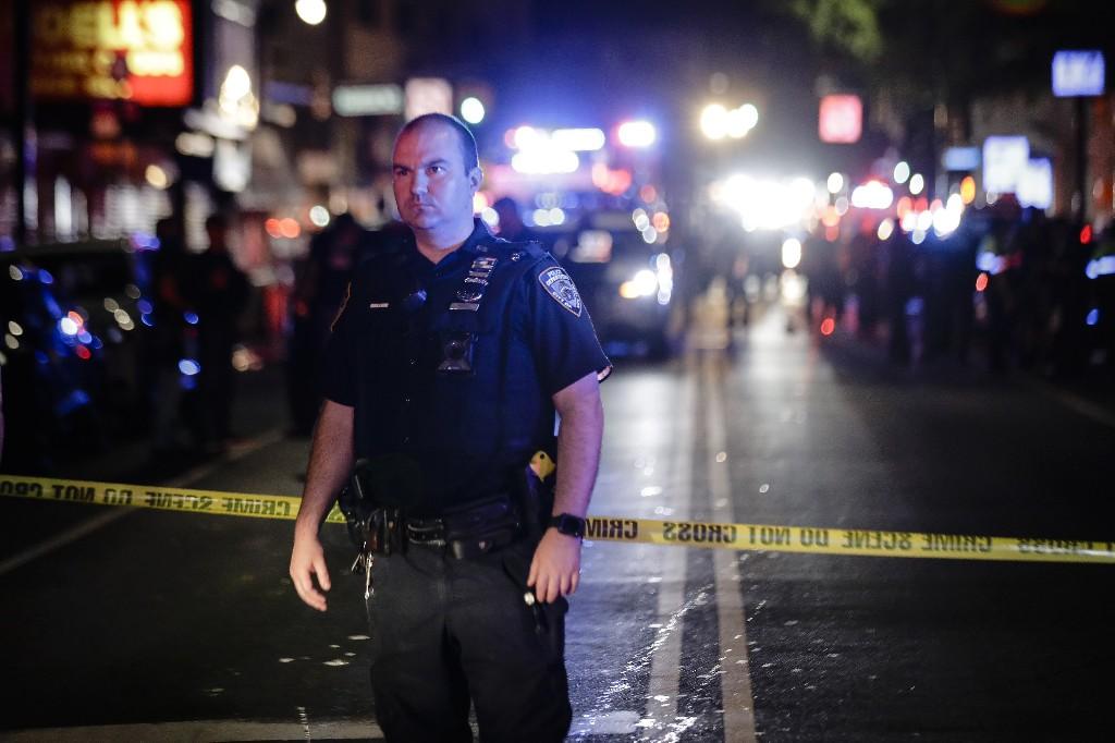 NYPD seeks motive after officer is ambushed, stabbed in neck