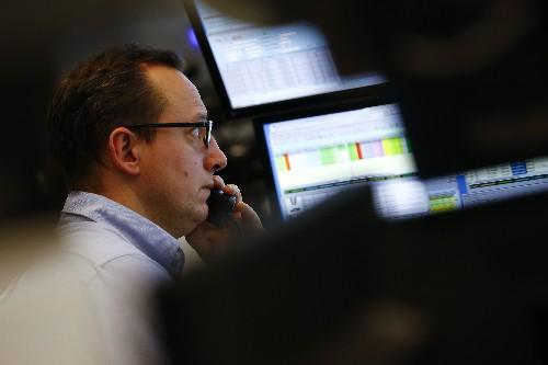Les Bourses grimpent, l'euro et les taux baissent après Draghi