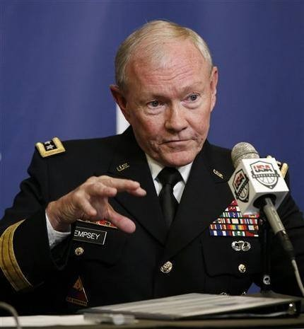 Obama again faces tug of military action in Syria