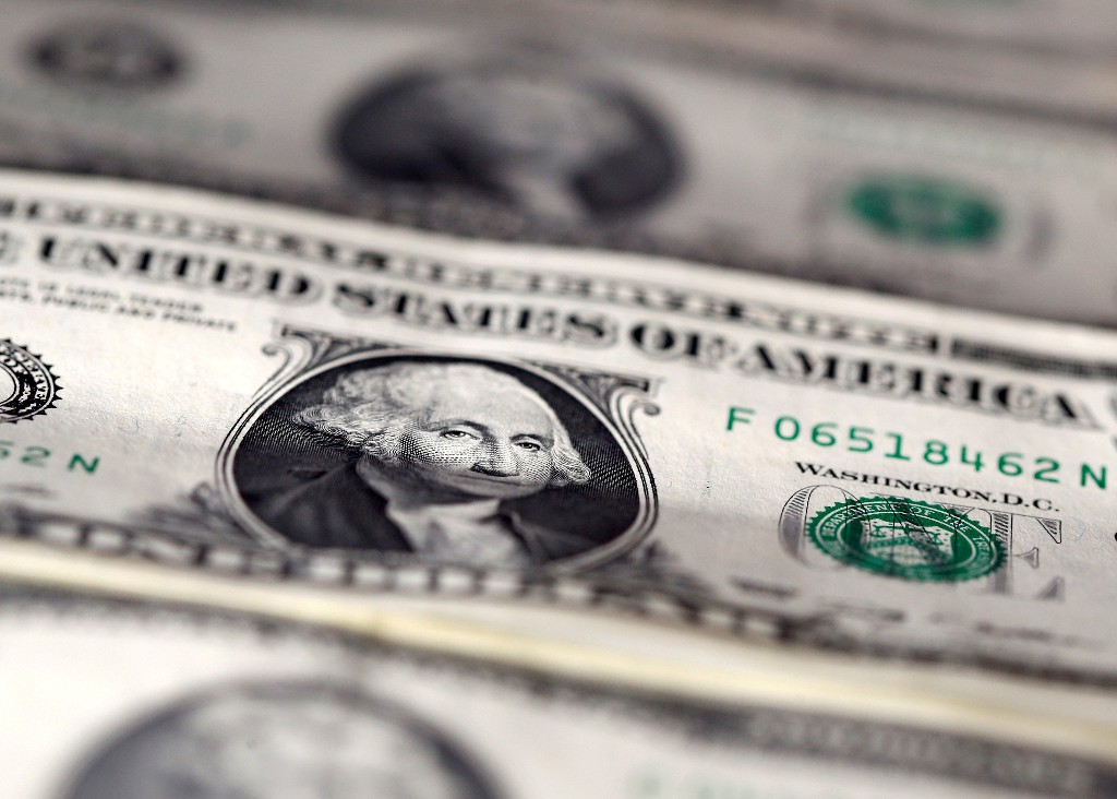 Dollar gains on U.S. election caution, surging COVID-19 cases