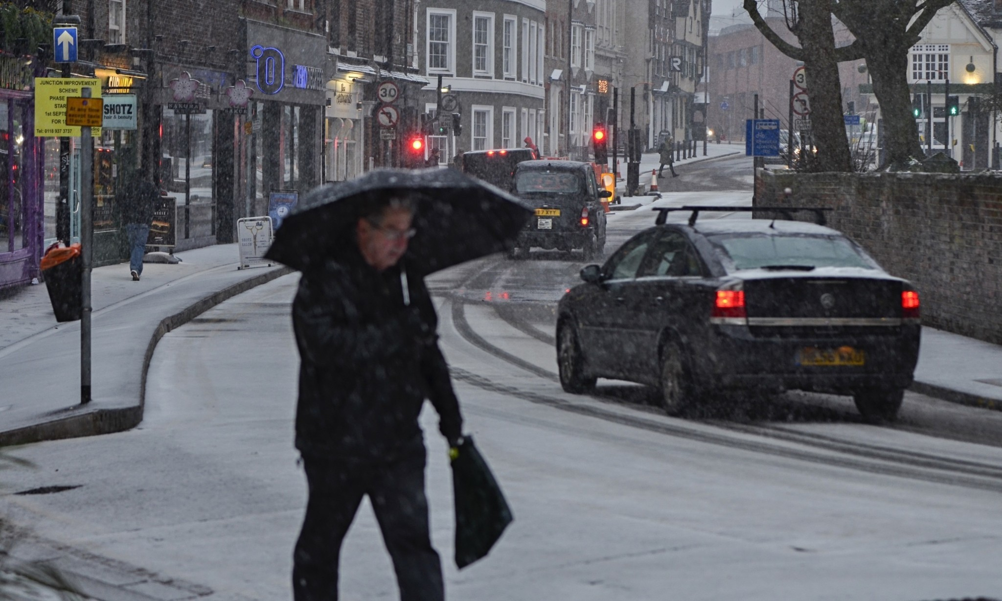 UK braces for further travel chaos as more snow blankets England