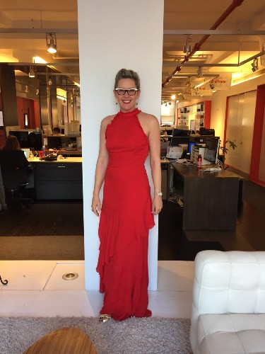 Christine in full glam Flipboard red representing at a gala tonight honoring Sir Martin Sorrell.