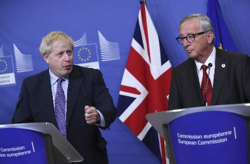 The Latest: EU nations still waiting for Brexit deal text