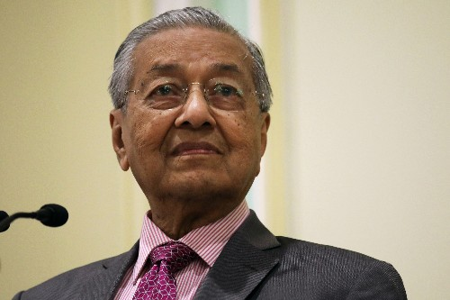 Malaysia PM suggests law to force companies to stop fires abroad