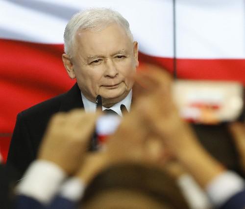 Polish conservatives win lower house but lose Senate