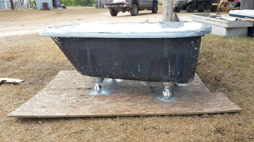 Sandblasted tub now the fun part I sprayed feet now porcelain for resr