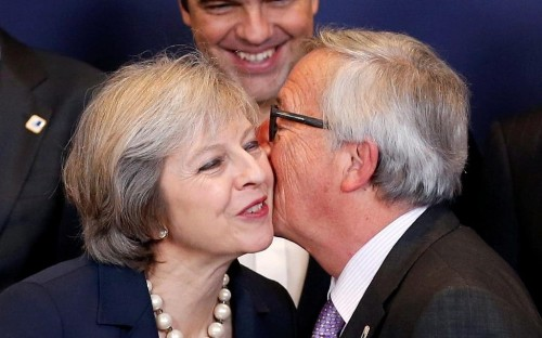 Theresa May to hold talks with Jean-Claude Juncker after series of threats at her first European Council meeting