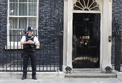 The Latest: PM May resigns, won't lead Britain out of EU