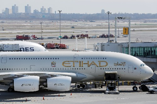 Abu Dhabi's Etihad to cut 50 pilots after big loss last year - sources