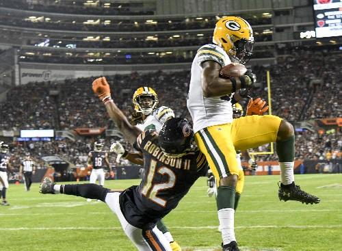 Packers' D, Aaron Rodgers beat Bears 10-3 in opener