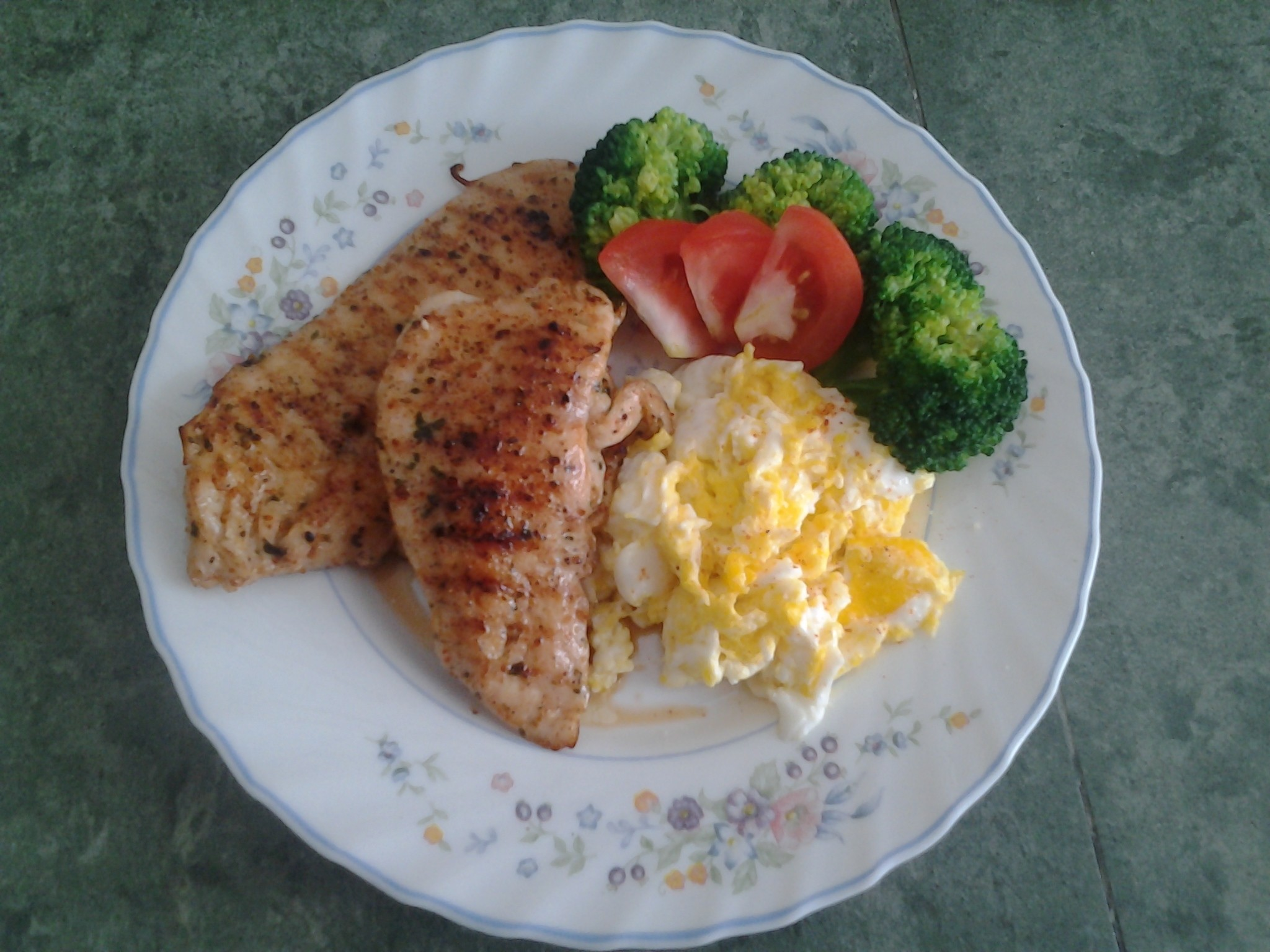 My style.. grilled chicken marinated , scramble egg,slices tomato and boiled broccoli