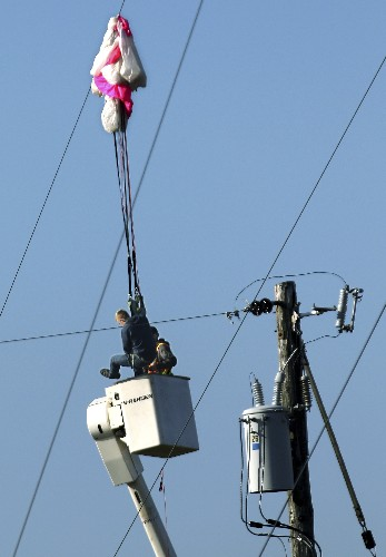 Illegal BASE jumper calls police after cell tower mishap