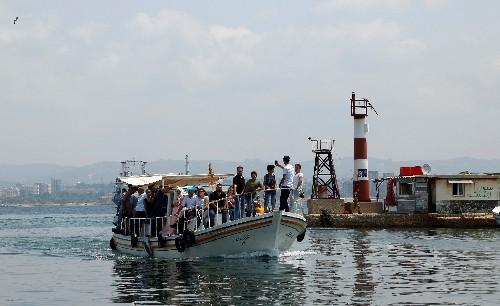 No shellfire or bullets, but war still intrudes on tiny Syrian island