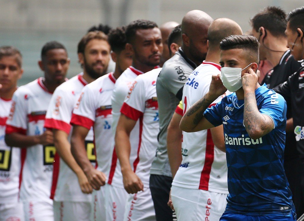 Brazilian team wear masks in protest at having to play