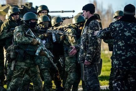 "Peaceful Russian troops taking over Ukrainian base in Crimea (as u can see , they are"" peaceful"" no arms)"