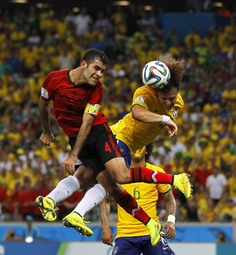 Ochoa Saves Mexico, Belgium Wins in Pictures