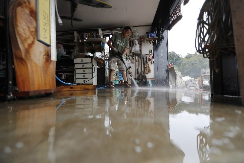 Japan storm victims felt worst was over, then floods came