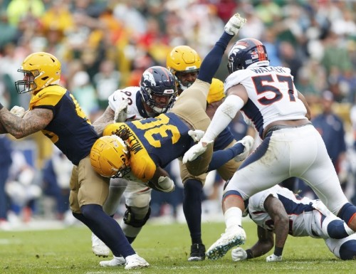 Packers sack Flacco six times in win over Broncos