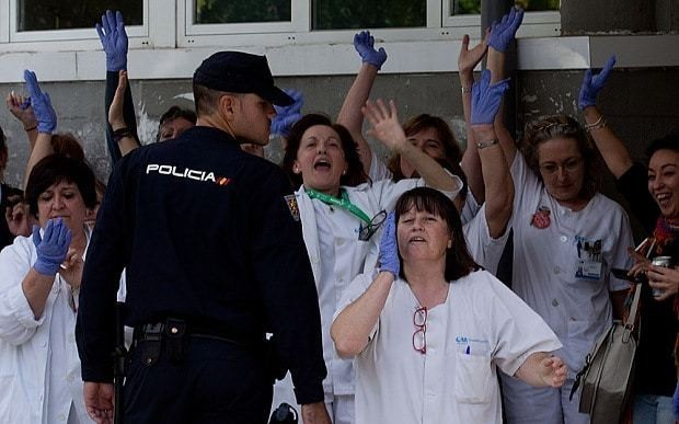 Spain sets up Ebola crisis team as angry health workers protest at PM's hospital visit