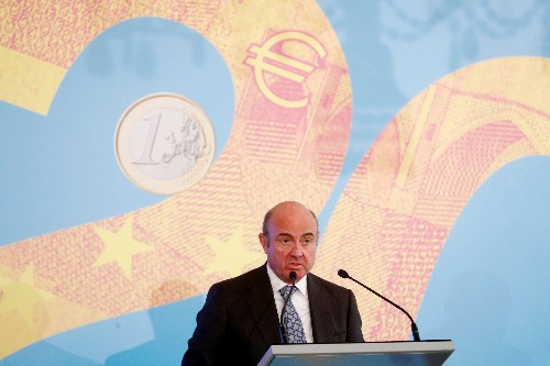 ECB's de Guindos keeps door open to more QE 'if needed'