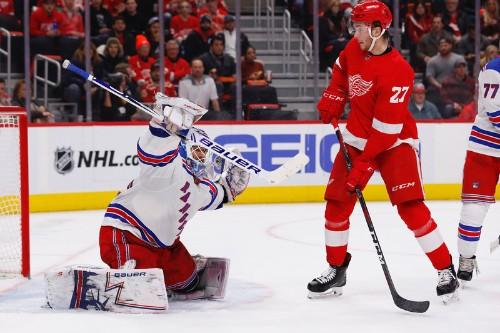 Wings win in OT, stop Rangers' run at 4