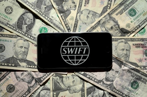 Costs of bank cyber thefts hit SWIFT profit last year