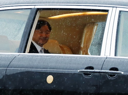 Some Japanese welcome emperor's enthronement, others shrug