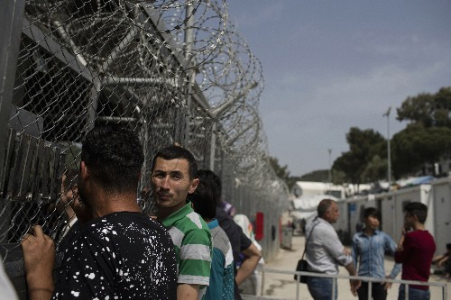 Amid protests, Greece suspends migrants detention plan
