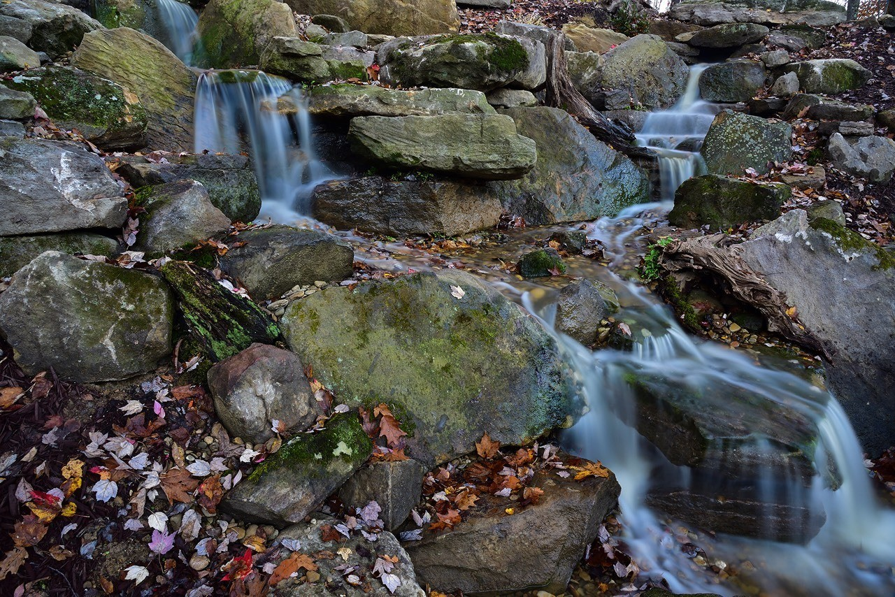 Waterfalls designed and installed by Aquatic Edge Looks like a natural waterfall in the woods!