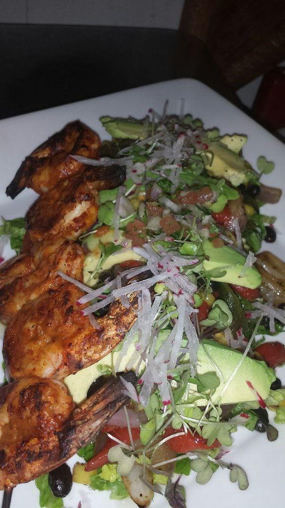 spicy grill shrimp over poblanos, avocado, corn, black beans and radish salad