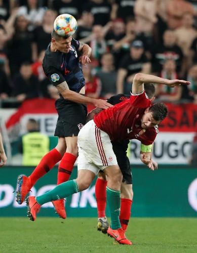 Soccer: Valiant Hungary fight back to stun Croatia 2-1