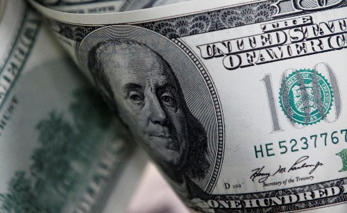 Dollar holds gains after Fed expresses virus concerns