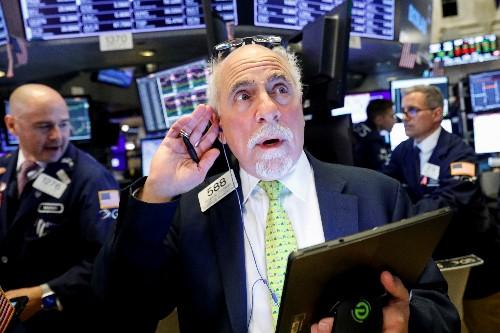Asian shares edge higher, pound stumbles on Brexit drama