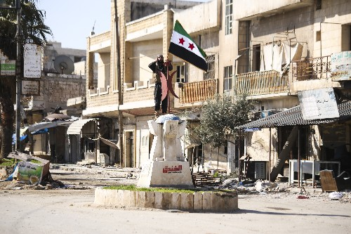 Activists: Syrian opposition fighters retake key town