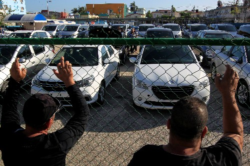 Cash-starved Cuban state sells used cars for dollars for first time