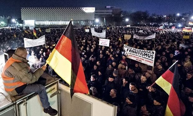 Estimated 15,000 people join 'pinstriped Nazis' on march in Dresden