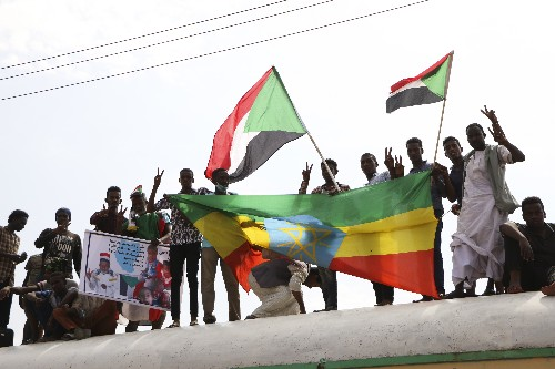 Sudan protesters, army announce new ruling body after deal